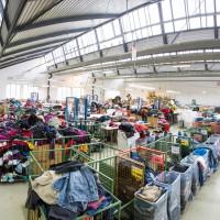 Sozialwirtschaftliche  Altkleidersammler sorgen für Dreifachnutzen